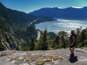 Dale Cody on summit of Squamish Chief cliff